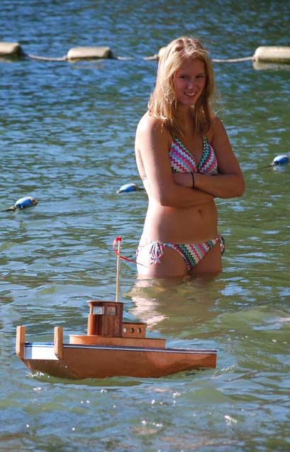 rc tug and girl remote controlled from shore